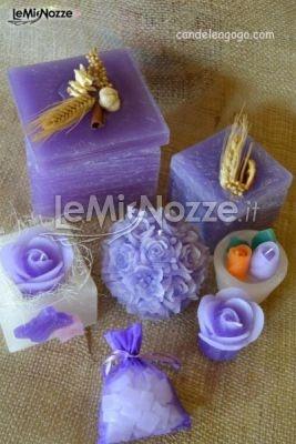 http://www.lemienozze.it/operatori-matrimonio/bomboniere/bomboniere-monza/media/foto/18  Mix candele lilla come bomboniere per il matrimonio