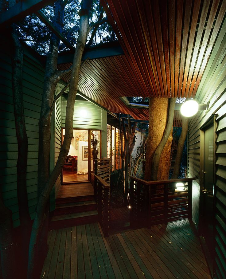 St Lucia House 1: Covered deck accommodates existing trees and creates transition space from outside to inside. See more at http://blighgraham.com.au/projects/st-lucia