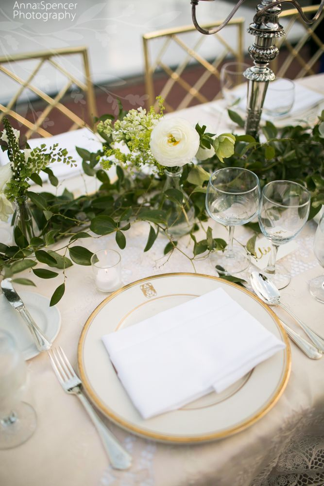 Wedding reception table garland with small white ranunculus and maiden hair fern.