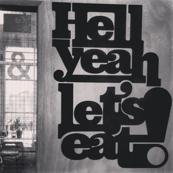 Laser cut Acrylic typographic wall art with bite!  3mm thick laser cut typographic Acrylic pieces. Spelling out Hell yeah, Lets eat! They are designed to be a pair that fit next to each other when fixed to a wall or door as shown. Supplied with double sided sticky pads to fix to most wall or door surfaces. Please take a look at the Fill your Cake hole pair, which compliment these, if you want some super feisty wall type that makes a statement!   Dimensions: Hell Yeah = (w)345mm x (h)250m...