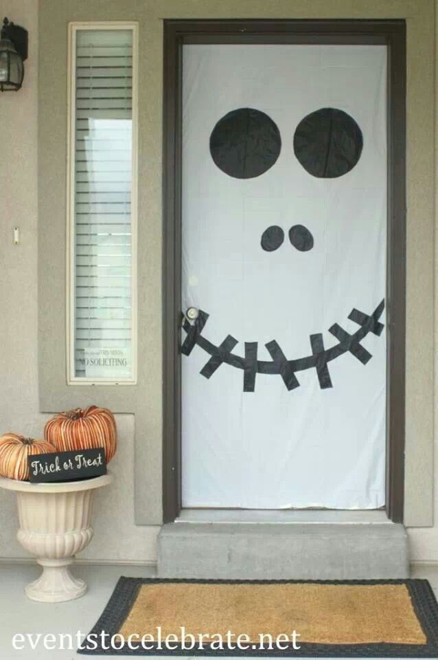 super simple halloween skull door decoration plus other fun ideas for decorating your doors or windows