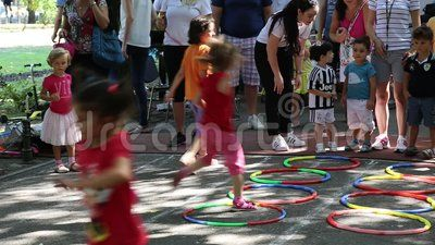 Child outdoor games - hoops game.