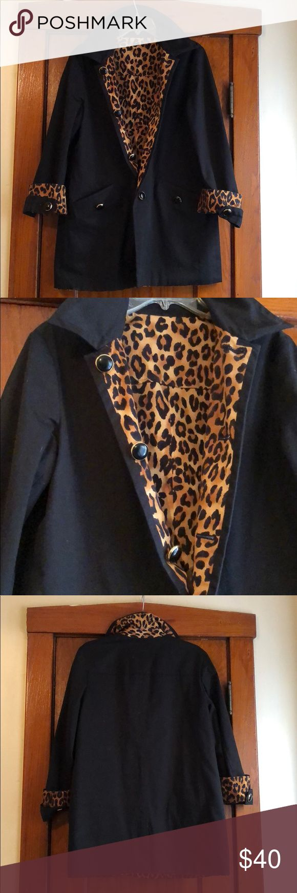 Black and Cheetah Print Coat Reversible Woman's Coat Black.and Cheetah Print. Can be worn on either side. Both sides have buttons and pockets. EUC measurements to come. Material is similar to a rain coat. Medium weight and will keep you warm. No tag or  brand. Jackets & Coats Trench Coats
