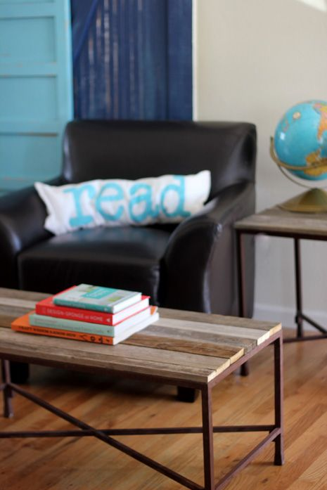 This pon is for a Do It Yourself: Reclaimed Wood Coffee Table in the picture, but I like the read pillow in the background!