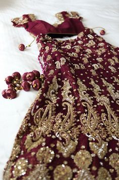 Red Gown ~ With paisley beading detail in gold.