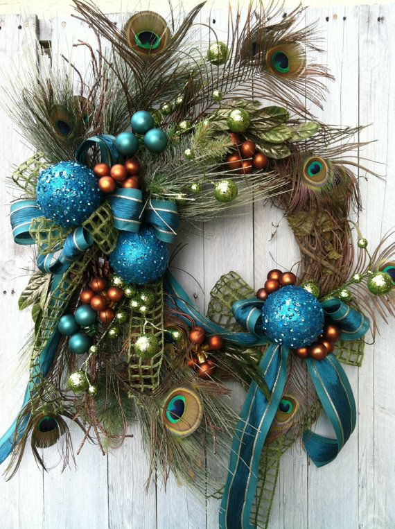 Christmas Wreath, Peacock Christmas Wreath, Teal Wreath for Christmas, Unique Christmas Wreath A Beautiful over the top glitzy peacock Christmas wreath for your front door. With purple added. This wreath is made on a grapevine base with peacock feathers, iced long needle pine, green glitter balls, bronze ornaments, teal ribbon, gold laurel leaf and teal glittered ornaments. If you want a show stopper for your front door, THIS IS IT! This wreath is approximately 35 from top to bottom and 26…