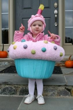 """Cupcake Halloween Costume -- Cut the bottom out of a laundry basket and cover with stuffing & fabric. The """"candle"""" is a toilet paper tube roll. CUTE!  @Christine Smythe Madsen AYLA HAS TO BE THIS ONE YEAR"""