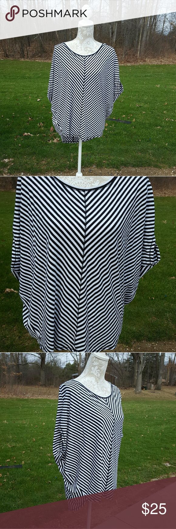 Calia by Carrie Underwood black and white top Worn once Size small Over sized fit  (Can fit up to a large) Short sleeves No Trades CALIA by Carrie Underwood Tops Tees - Short Sleeve