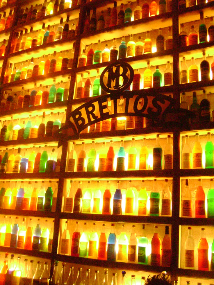 100 year old bar in Athens, Greece (stained glass bottle wall for the hallway)