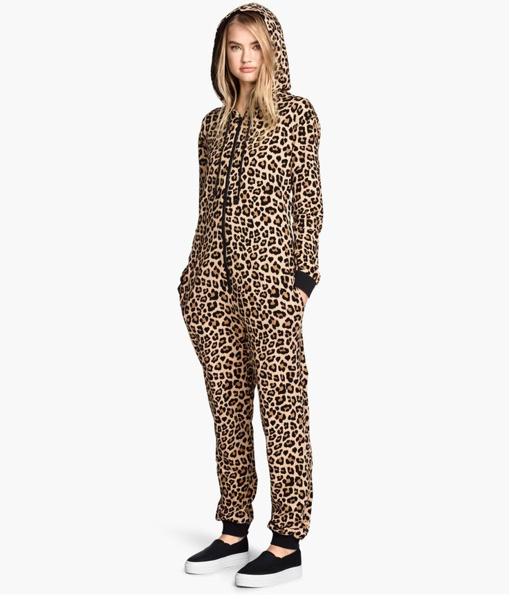 Lounge like a jungle cat in this leopard-print jumpsuit with sweatshirt fabric, drawstring hood, and front zip.   H&M Divided