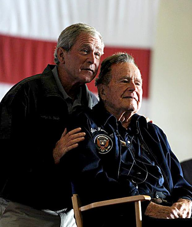 Father and son Presidents George H. W. and George W. Bush.