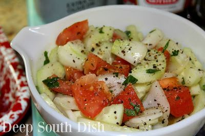 Simple Summer Cucumber, Onion and Tomato Salad. A favorite simple salad in the summer, featuring garden fresh cucumbers and tomatoes, red or sweet onion, and dressed in a simple homemade vinegar and olive oil Italian dressing.
