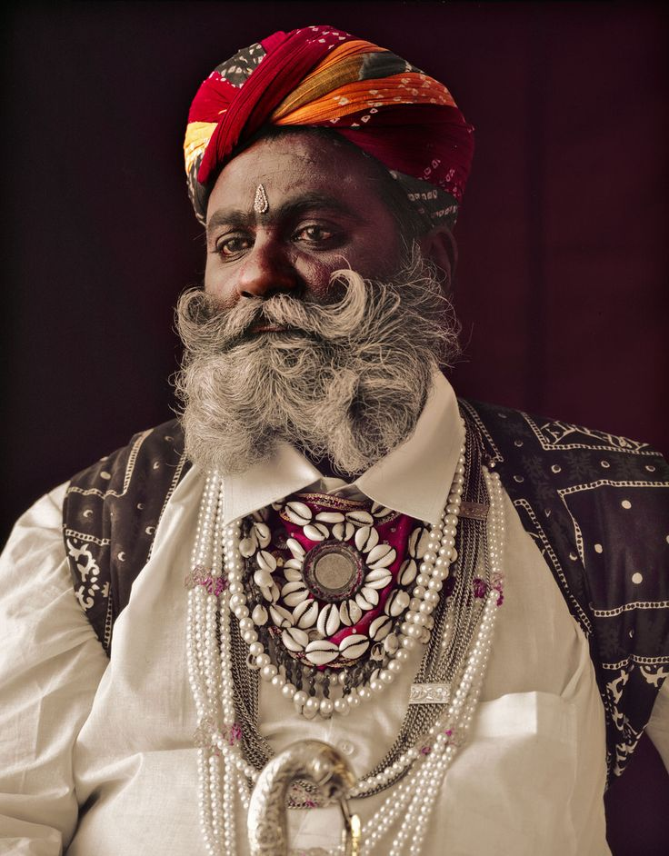 A Rabari man commonly appears in white dress, sporting golden earrings.  Although only about one to two percent of the Rabari still practise an entirely nomadic lifestyle, the main sources of Rabari income remain livestock and related products such as milk, wool, leather and dung. Shepherds are often hired to herd the combined livestock of entire villages, with flocks sometimes numbering more than 500.