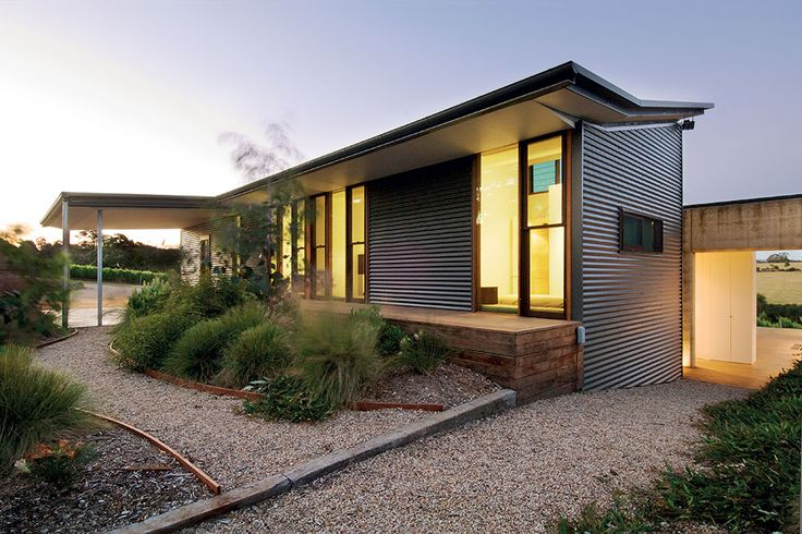 The rear garden is an intimate space planted with native Australian grasses. The intimacy of the garden is achieved by responding to the existing slope of the site | Hill House by Mihaly Slocombe (2006) | Merricks, Victoria, Australia | photo: Emma Cross