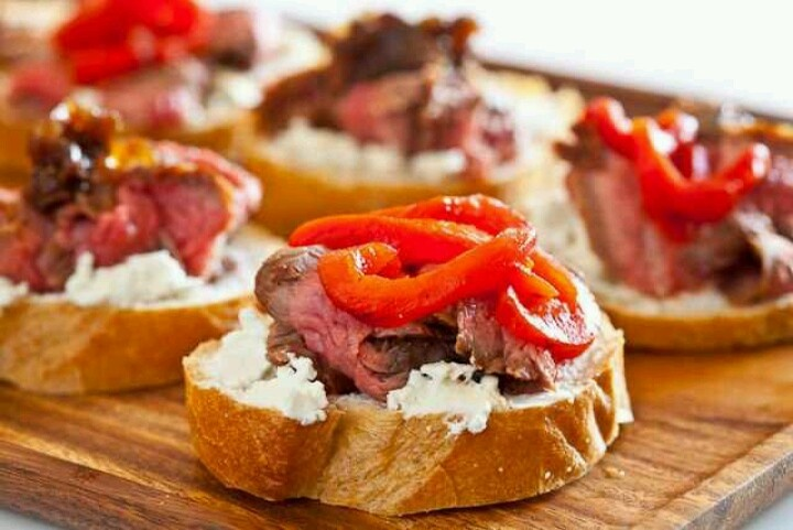 Flank steak with goats cheese on toast