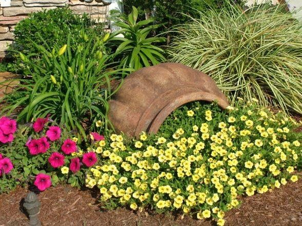 "A great idea for a broken pot to create a ""spilled flowers"" affect…"