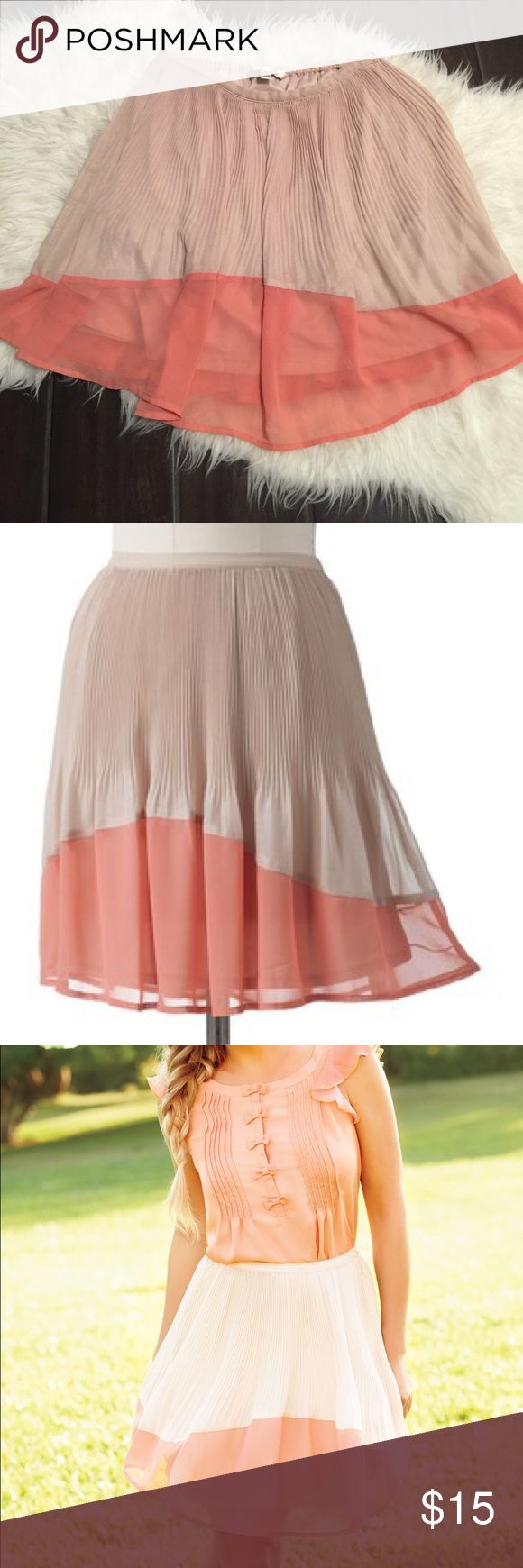 Lauren Conrad chiffon pleated coral tan skirt Excellent used condition women's size small pleated skirt. Tan area has a slight iridescent sheen to it. No trades. LC Lauren Conrad Skirts