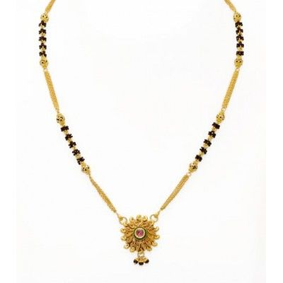 A short mangalsutra with an appealing pink gemstone right in the center