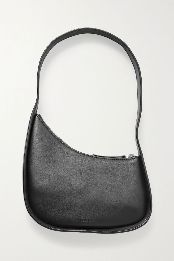 The Row's leather bag is modeled after popular mini silhouettes from the '90s, but it still has plenty of space for everyday essentials. It has a curved 'Half Moon' shape and opens to a suede-lined interior sized to fit your phone, cardholder and keys. The wide strap is just long enough to sit comfortably under your arm. The Row Bag, Summer Handbags, Leather Shoulder Bag, Shoulder Bags, Black Shoulder Bag, Fashion Bags, 90s Fashion, Calves, Keys