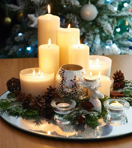 Give your home a luxury feel with this Christmas candle display on a mirrored base. | Tesco