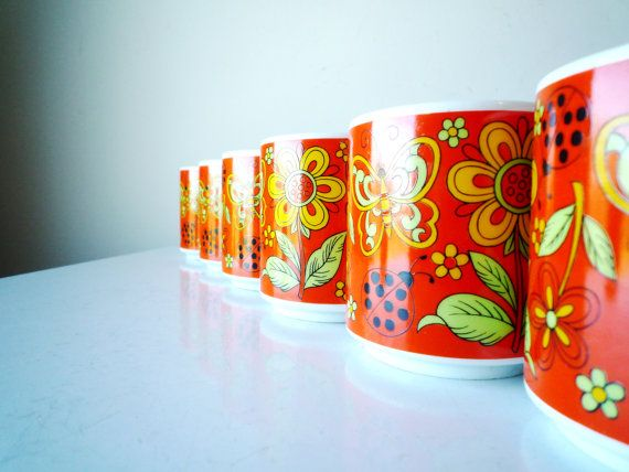 Bright floral coffee mugs with metal storage tree. Still in original packaging. Gorgeous color and pattern. Mint condition.  BLACK FRIDAY SALE