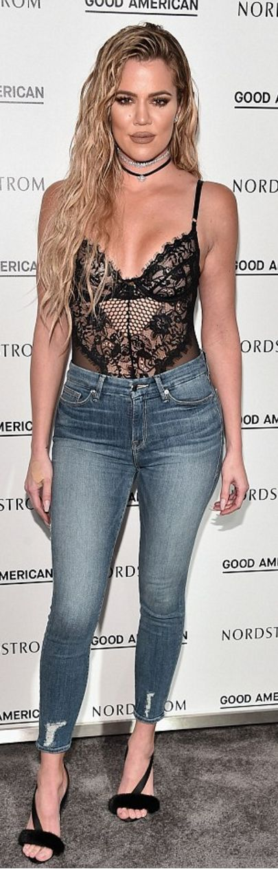 Khloe Kardashian: Necklace – Fallon Monarch  Shoes – Olgana Paris  Shirt – Gooseberry Intimates  Jeans – Good American