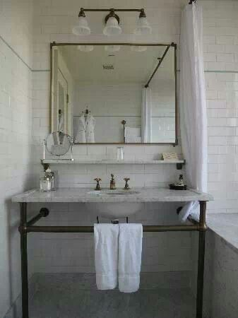 Sink base made of iron pipe-- doubles as a towel bar. Maybe a simple DIY?