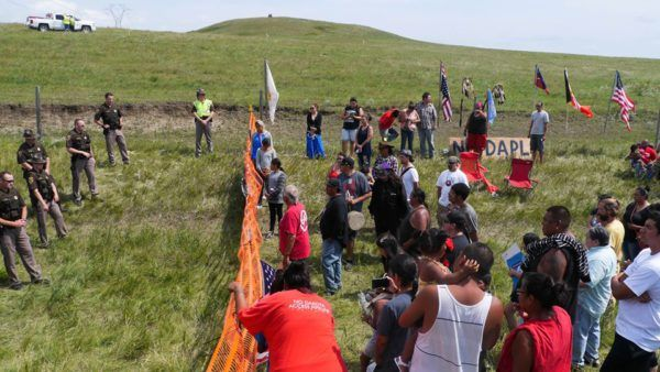 North Dakota's Standing Rock Sioux aren't backing down to oil pipeline developers  by Sarah Aziza, Waging Nonviolence, August 12, 2016 On Thursday, nonviolent protesters outside North Dakota's Standing Rock Sioux reservation entered their second day of confrontation with private security and local law enforcement. Armed with drums, tribal flags, and cell phones, demonstrators moved to block the construction of the Dakota Access Pipeline, a $3.7 billion dollar crude-