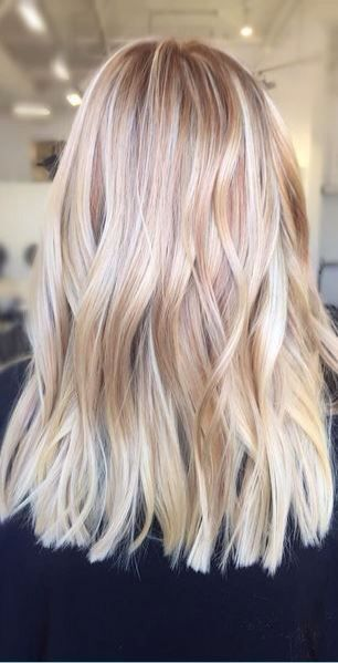 Cool and warm toned high level blonde with varying tones