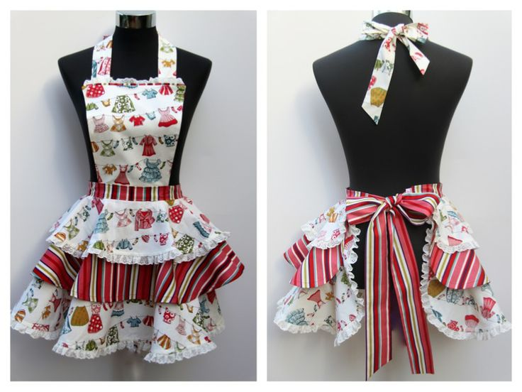 """Mondays on My Mind"" Ladies  3 tier apron  Price $60 plus postage The soft quality craft fabric has a delightful pattern of colourful clothes on a line, on a cream background.  Three separate tiers, one in contrasting stripes, curving up at the back and joining at the waistline of stripe fabric tying with a large bow at the back. The double sided bib and hemlines.  Fabric sold out, available using fabrics of your choice.   Handmade in Australia.  e: alollycreation@gmail.com"