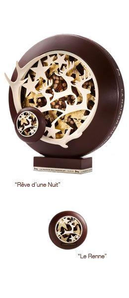 """Noël 2013 - Nicolas Cloiseau - La Maison du Chocolat - Paris - Un disque de mendiant serti de pistaches, d'amandes, de noisettes, de noix de pécan, de billes de chocolat et de grué de cacao, entraîne ce rouage gourmand - """"Rêve d'une Nuit"""" : pièce artistique en édition limitée, entièrement réalisée à la main. Taille unique de 5.95 kg, 45 cm de haut, 39 cm de diamètre et 22 cm d'épaisseur - """"Le Renne"""" : pièce entièrement réalisée à la main. Taille unique de 120g, 12 cm de diamètre."""