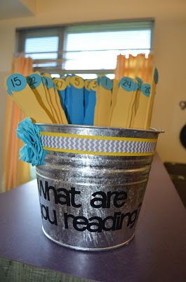 I saw this idea  and made it my own. Each student has two sticks (one yellow and one blue). My kids are allowed to only have two books out of my classroom library at a time. So when they take a book they put the stick in it's place. This lets me quickly see who is reading, and what they are reading (my library is set up by genre, author, and series). I don't have labels yet, the ones I used before are too big. dandelions and dragonflies: An Oregon Classroom Reveal!
