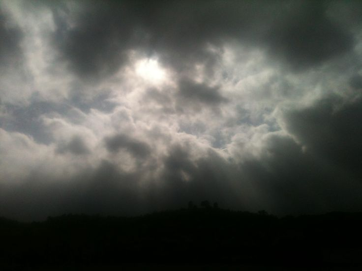 rayed sun and fluffy clouds