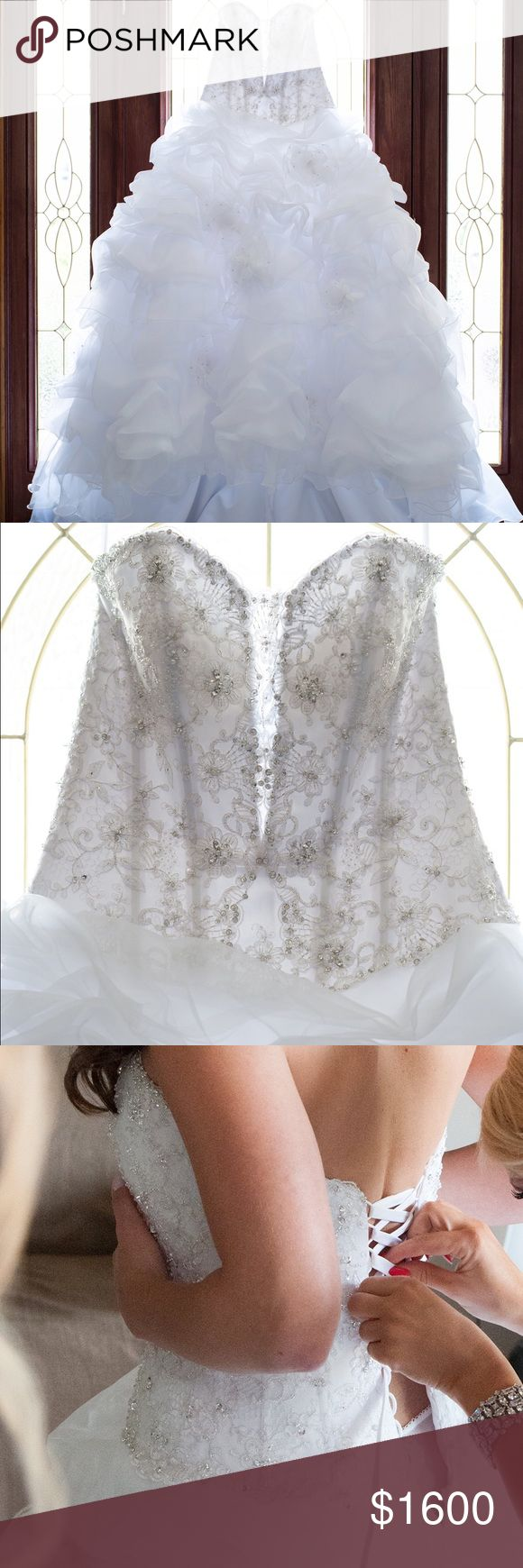 Gorgeous white Allure Bridal Wedding Ball gown Mint condition Allure C710 wedding dress worn once in church wedding/indoor reception. Professionally dry cleaned & preserved ($150+). Strapless ball gown features a unique sweetheart neckline, embellished with embroidery & Swarovski crystals. Back ties up allowing for a snug or loose fit or to adjust to a smaller or larger size & has a privacy panel to clip under the tie up. Skirt has soft pick-up details accented w/feathered flowers. White…