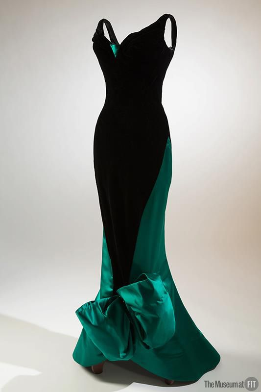 Evening dress in black velvet and green satin, circa 1955. Collection of The Museum at FIT.  This evening dress features a three-foot long metal zipper that spirals around the body. Charles James revolutionized the way designers incorporated zippers into their work when he began placing zippers on the bias in 1929.