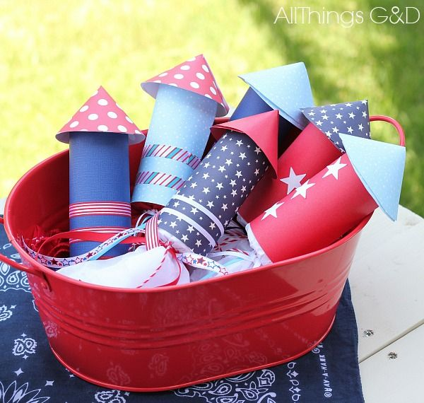 Cute idea for shower favors, too.     Just change up the paper design to bridal or baby theme and fill with gourmet candy, etc.  Fourth of July Candy Rockets