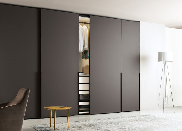 The Ghost corner wardrobe from Jesse Furniture, Italy has gorgeous glass doors with a slimline aluminium profile and an integrated 1.2 metre long handle in a brown finish.