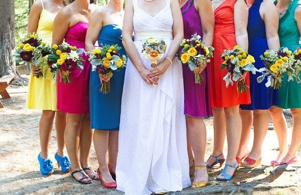Multi-colored bridesmaids dresses! Love this!
