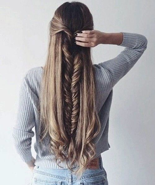 Half up half down hair style featuring a long and thick fish tail braid and curled tips. #hairspiration