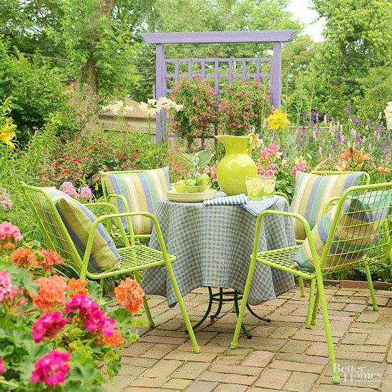 Create a colorful corner protected from breezes for a place to enjoy a morning cup of coffee or glass of orange juice. Your day will seem brighter when you begin it with a contemplative moment in the garden. Pretty and cheerful linens and chair cushions make the spot even more inviting./
