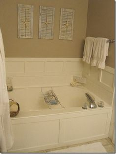This is a builder grade garden tub which the homeowner spruced up with MDF and plywood panels to give it a custom look. Great idea! I love my tub but not the fake tile surround.