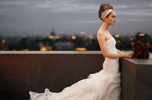 Vera Wang - strapless draped organza fit and flare gown with draped bodice and hand-cut bias flange skirt $1,200