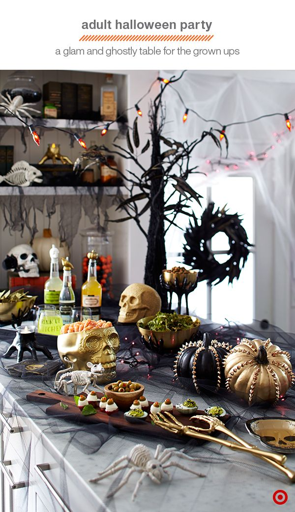 Create a Halloween spread worthy of the most sophisticated ghosts and goblins with a combination of snacks, drinks, and edgy decor. Every detail, from the mix of black and gold to the eerie animal skeletons works together in this festive yet stylish setup.