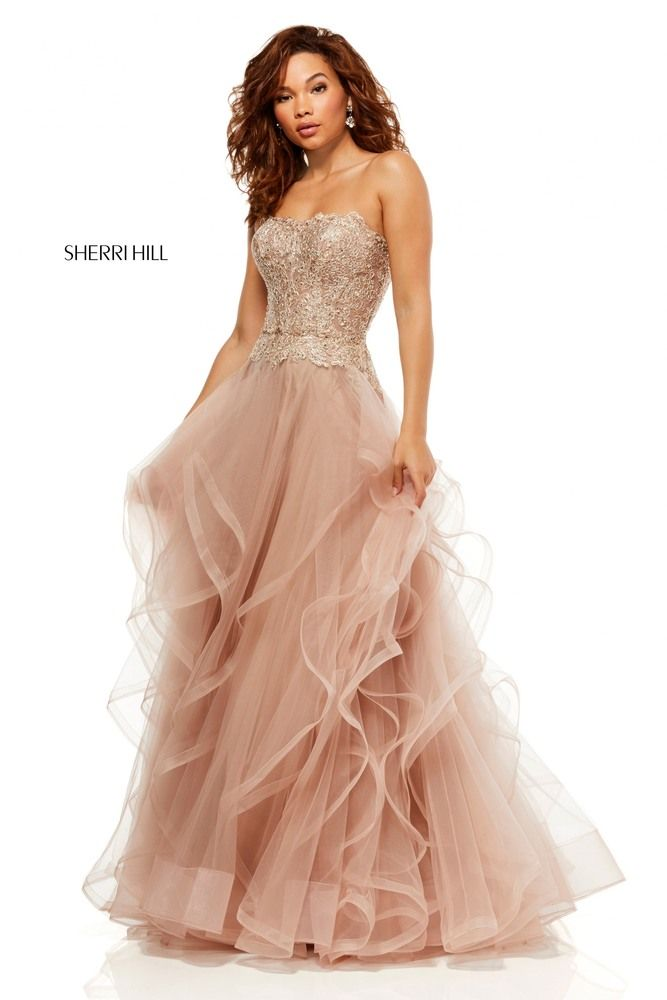 This Sherri Hill 52504 rose gold prom dress features a beaded lace bodice  over a flounce ballgown skirt de741a0ef