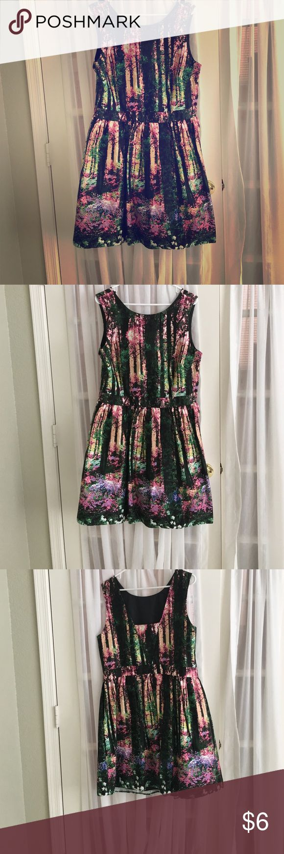 Pretty Primark dress, size US 16 NWT Multi colored beautiful pattern. Tight around the top and then flowing skirt, goes to just above the knee. This is from British department store Primark. The dress is never worn and new with tags. Primark Dresses Mini