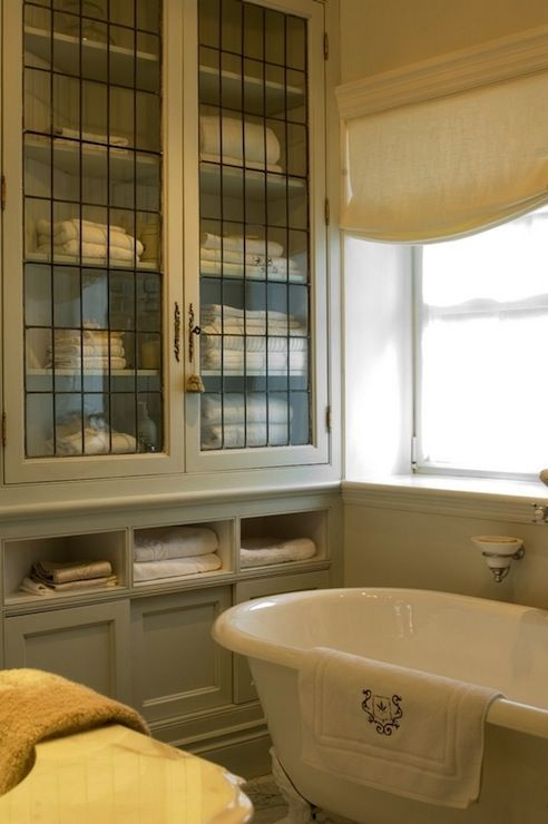 Suzie: Julie Charboneau -  Ethereal French bathroom design with gray built-in bathroom cabinet ...