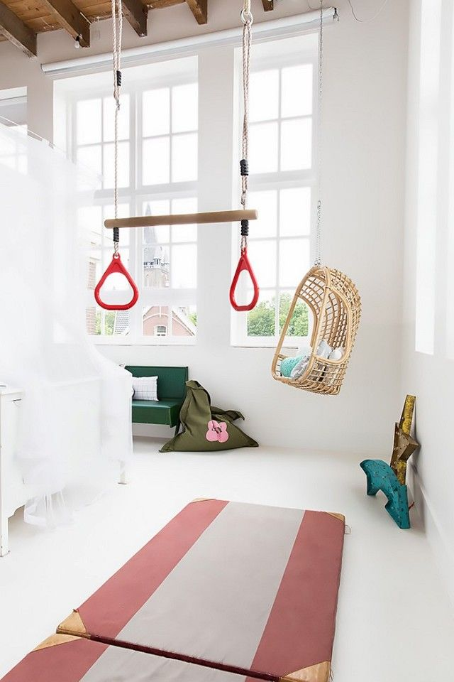 Minimalist inspired kids' room with a trapeze bar