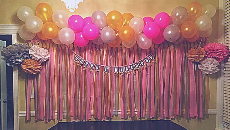 DIY balloon banner, plastic table cloth back drop, and tissue paper flowers. Super inexpensive! Everything purchased at the dollar store!  Ready for Jaleigh's birthday party this Saturday!