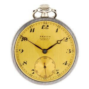 LOT:139 | A niello decorated continental white metal keyless wind open face pocket watch by Zenith.