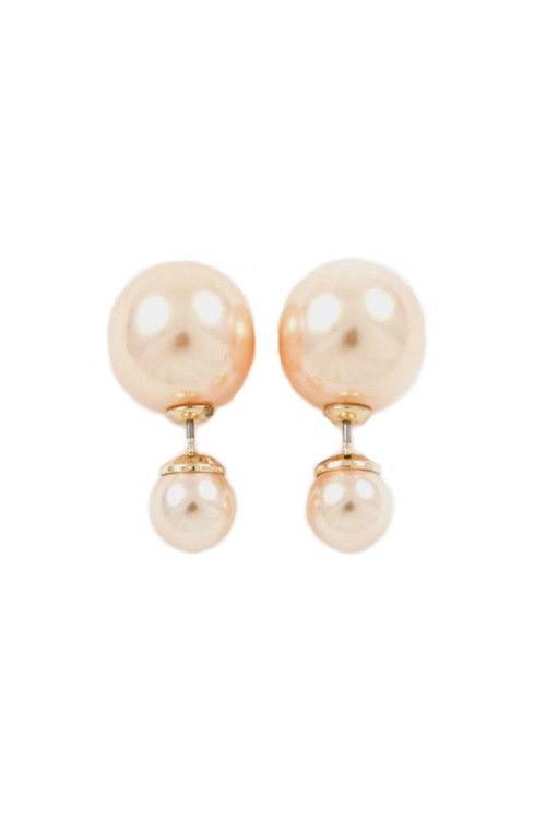These double sided earrings are all the rage this season. Peach colored pearls are in front and behind the ear lobe. The front end pearl is approximately 1/4 inches and the back end pearl is approximately 3/4 inches.